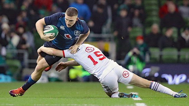 Andrew Conway is tackled by Will Hooley in Ireland v USA match