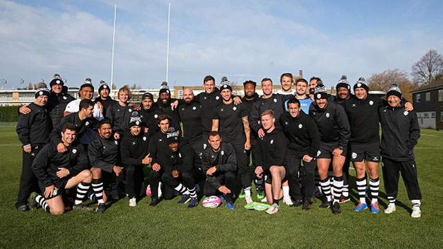 Barbarians players and coaching staff pose for a team picture