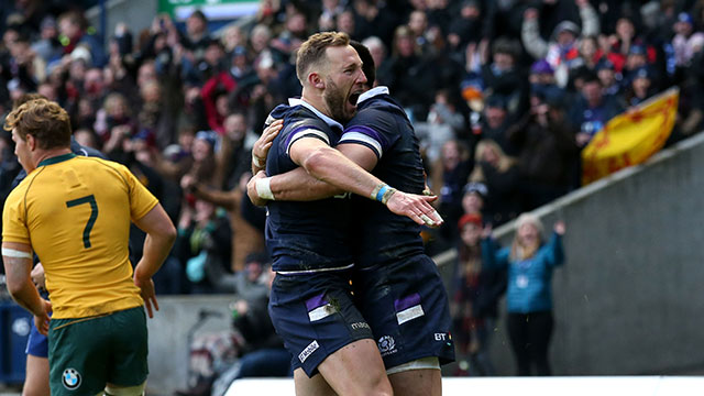 Byron McGuigan celebrates scoring Scotland's first try against Australia