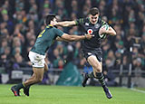 Jacob Stockdale fends off South Africa's Damian de Allende