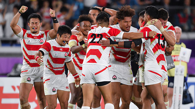 Japan players celebrate at the final whistle after beating Scotland at World Cup