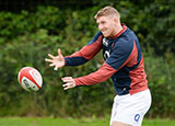 Ruaridh McConnochie passes the ball during an England training session